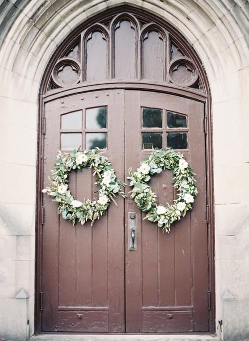 greenery wedding wreath on door