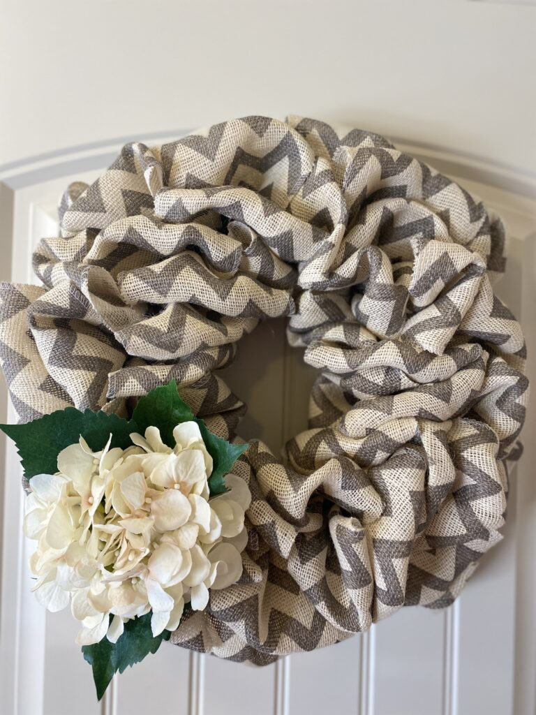 Modern spring burlap wreath design with chevon burlap ribbon in beige and gray.